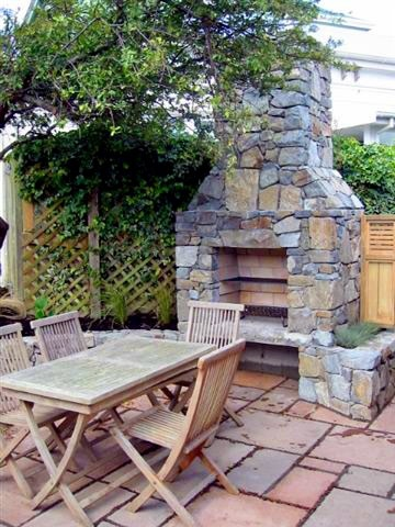 Realstone paving with yet another large outdoor fireplace / barbeque for those cool Wellington evenings.