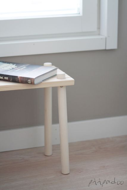 DIY bedside table = broom handle + a wooden shelf