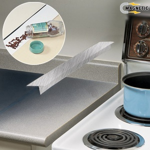 SPILL GUARD (ALUMINUM) - Slips in space between counter top and stove ...