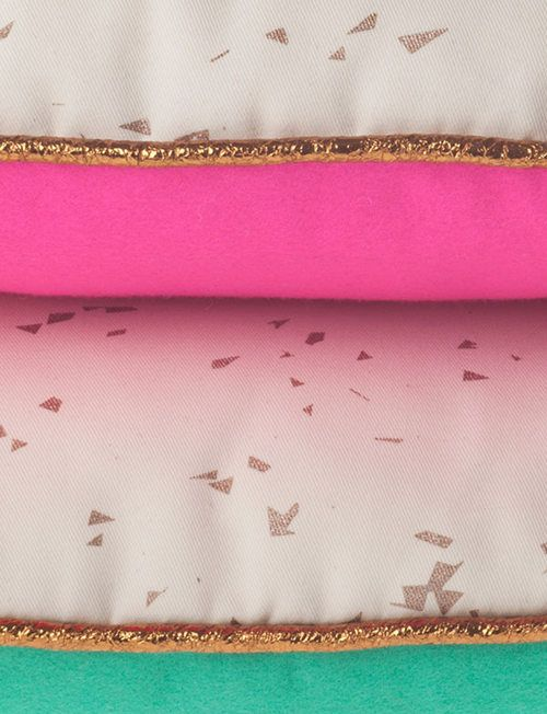 Gold piped cushions