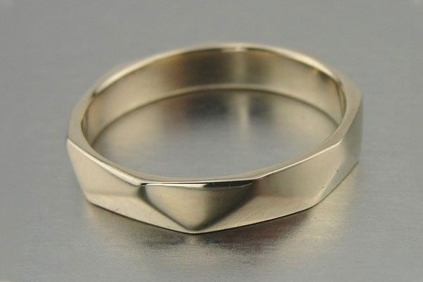 16 Alternative Wedding Rings For Guys!  #refinery29  http://www.refinery29.com/alternative-wedding-rings-for-guys#slide-9  HadasGold Exclusive 14k Yellow Gold Mens Wedding Band Ring, $399, available at HadasGold.