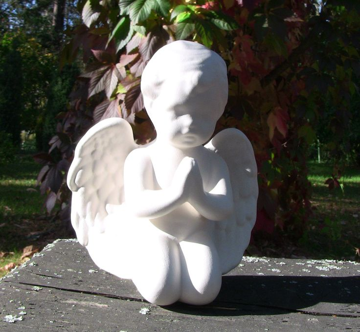 Small white angel is made of ceramic. Size is about 16 cm.