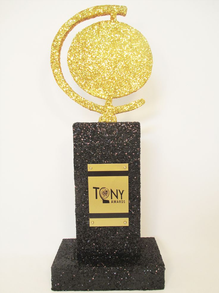 We love this tony-awards-centerpiece how about making some small ones to give awards for best dressed, best hair, Best dressed couple etc.