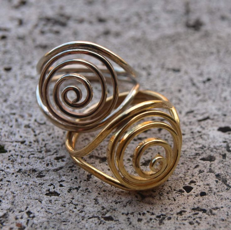 Le Metissage   Silver and brass rings with spirals