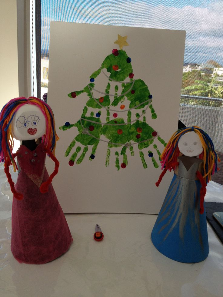 hand print xmas tree + dolls from recycled materials