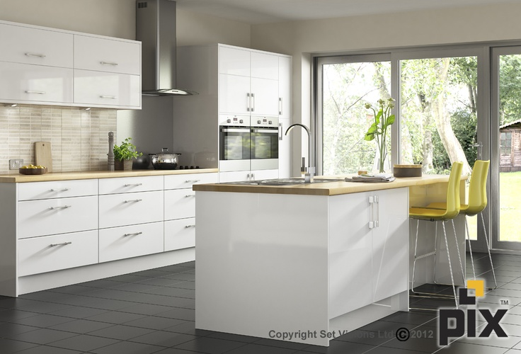 Aluminium sliding doors and slate floor add to the contemporary fresh kitchen. Travertine mosaic splashback with oak worktop and a pop of yellow bar stools add to the Scandinavian trend http://www.setvisionspix.co.uk/
