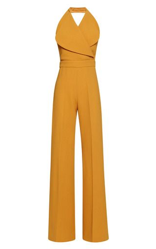 This mustard wool crepe Emilia Wickstead jumpsuit features a rounded spread lapel, a mock wrap front construction at the bodice, an wide waist band and a high-waisted, tailored wide leg.Hidden zip back closure100% woolFully linedMade in ItalyPlease note: This item may be returned for M'O credits or full refund.