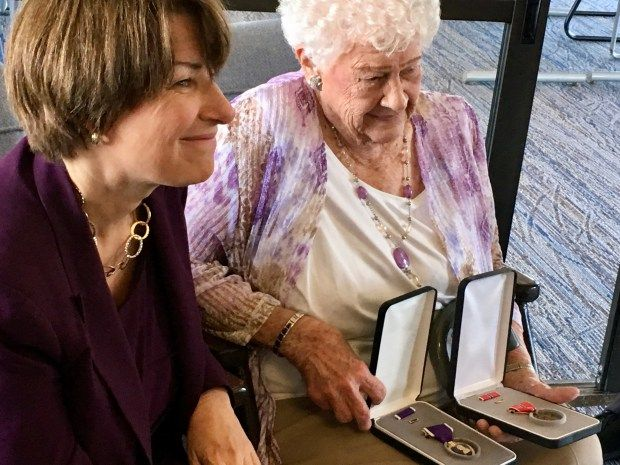 U.S. Senator Amy Klobuchar presents Catherine Tauer with the Bronze Star and Purple Heart medals that her late husband Staff Sergeant Gerald Jacobsen earned during World War II. (S. M. Chavey / Pioneer Press)