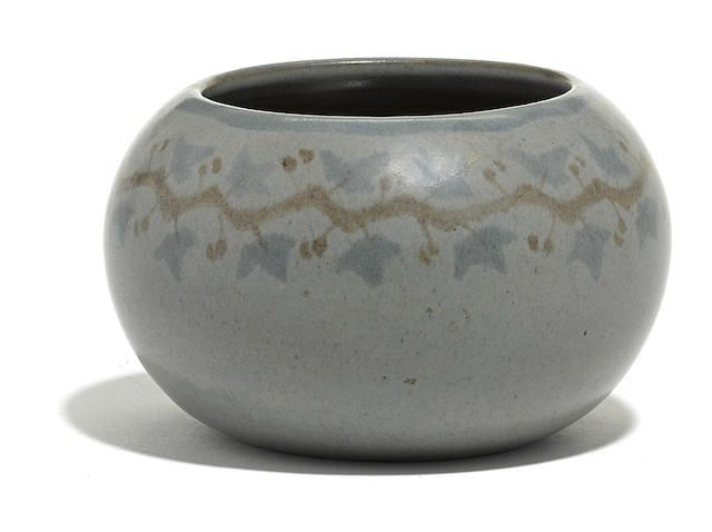 A Marblehead Pottery blue glazed earthenware bowl with ivy band designed by Arthur Irwin Hennesey, decorated by Sarah Tutt. Sold for US$ 937 (AU$ 1,214).