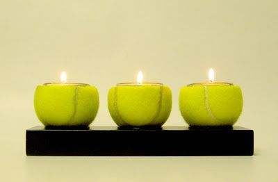 old tennis balls into candles! Would be a fun decoration for a tennis themed event such as a birthday party or tennis themed bar or bat mitzvah