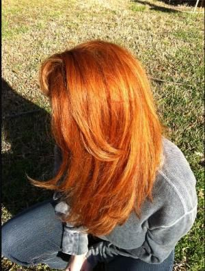 Wella color to create this orangey/copper red that looks stunning in the sun: 6/34 + 7/43 and highlights.