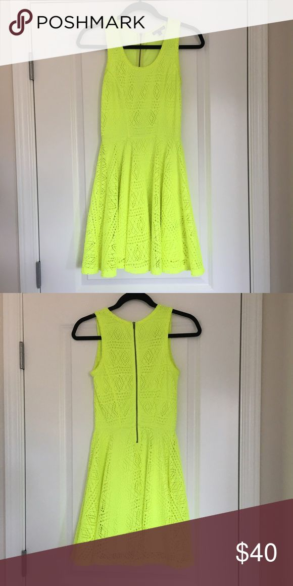 Neon Yellow dress Neon yellow fit and flare dress. Fully lined. Lazer cut pattern. Fits true to size. Like a highlighter yellow. ✨OFFERS WELCOME✨ Express Dresses Mini