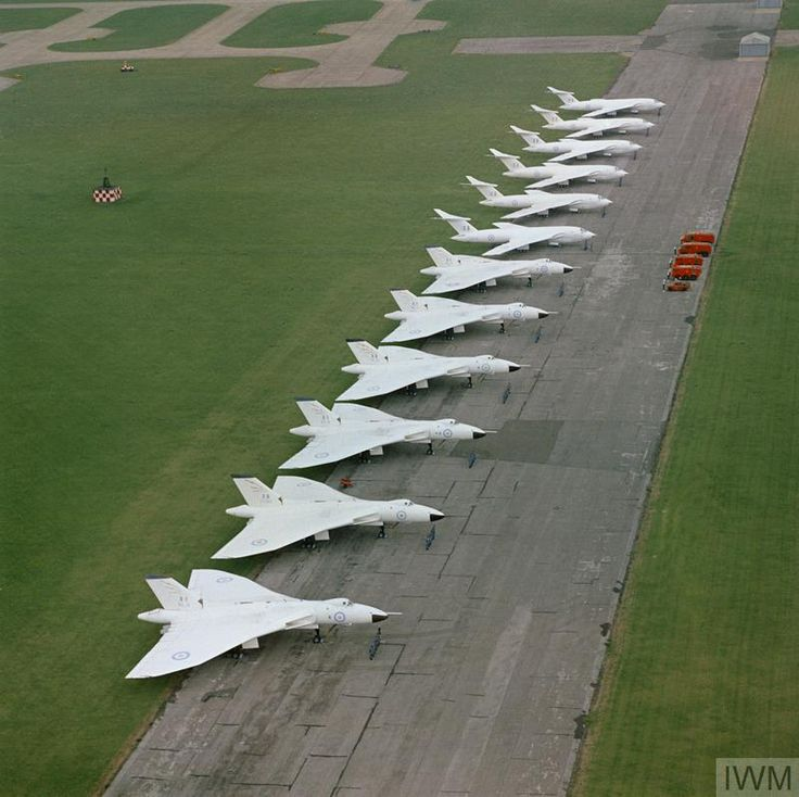 Six Avro Vulcan B.2 aircraft of No 617 squadron and six Handley Page Victor B.2 aircraft of either No 100 or No 139 Squadron (from RAF Witttering) lined up at RAF Scampton. These Vulcans and Victors are painted in their 'anti-flash' white paint-scheme.
