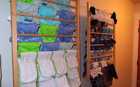 Turn an old crib into a wall mounted drying rack!