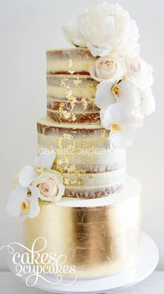 Naked wedding cake with gold leaf and fresh flowers