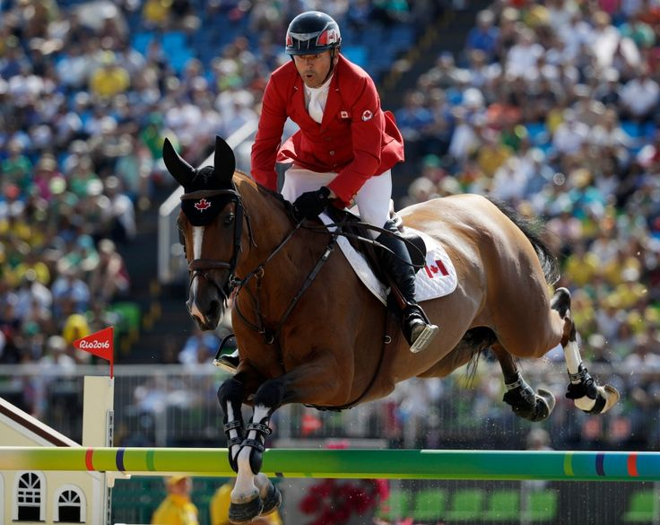 Canada's Eric Lamaze, riding Fine Lady 5, competes in the equestrian jumping competition at the 2016 Summer Olympics in Rio de Janeiro, Brazil, Tuesday, Aug. 16, 2016. (AP Photo/John Locher)