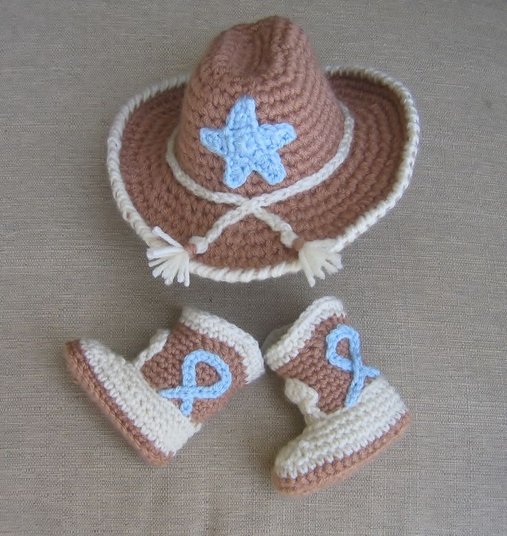 Another western baby set.  Crochet cowboy hat and boots in baby blue, cream and light brown.