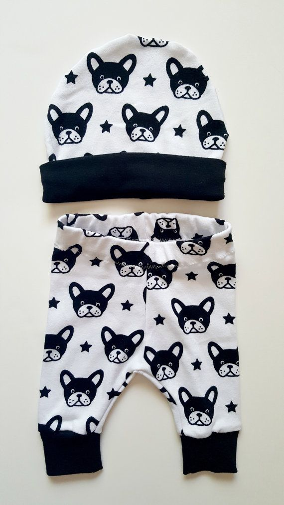 Baby boy clothes, trendy baby boy, baby leggings, dog print baby set, baby leggings, baby beanie and pant, baby boy gift, bull dog baby boy, new baby, fall baby clothes, baby shower gift  This sweet baby boys pant and beanie set is made from a black and white interlock cotton. Featuring little bull dog heads and stars. This set is trendy and perfect to cuddle your baby boy up in this fall. Available in sizes newborn- 12 months. All seams are professionally serged for quality and durability…
