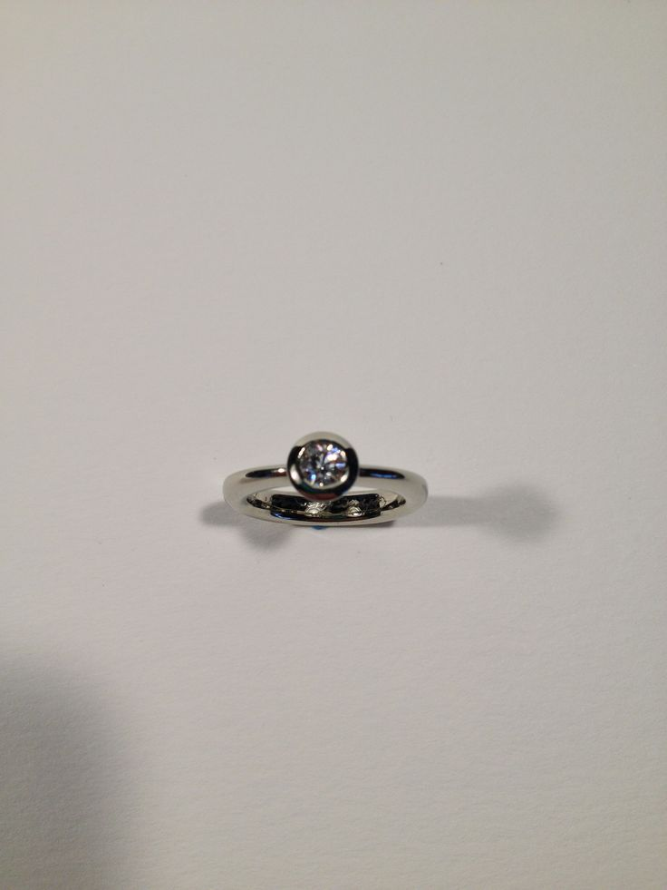 Diamond ring 18 kt gold. Canadian diamond set in a contemporary rendering of a classical Italian style engagement ring. Completely hand made in Vancouver. Please contact me for quotes and to schedule an appointment.