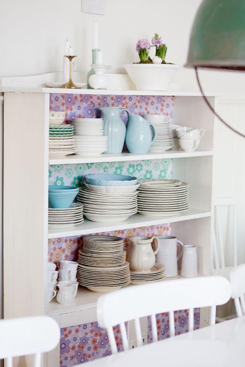 diy dresser backing with vintage floral wallpaper..
