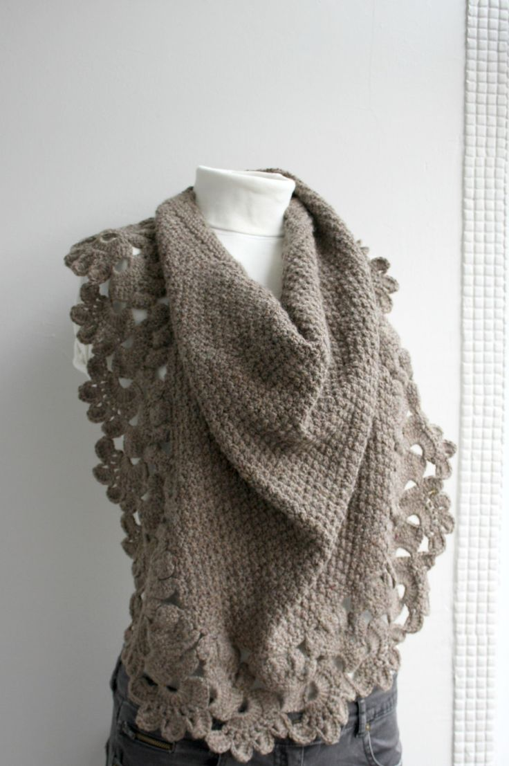 Pretty scarf... looks like it's all crochet, but I would make it with a knit seed stitch center and Queen Anne crochet edging