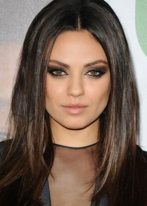 Celebrity Mila Kunis appears smoking hot with her poker- striking dark eye makeup and straight layered locks. Description from long-hairstyles.com. I searched for this on bing.com/images