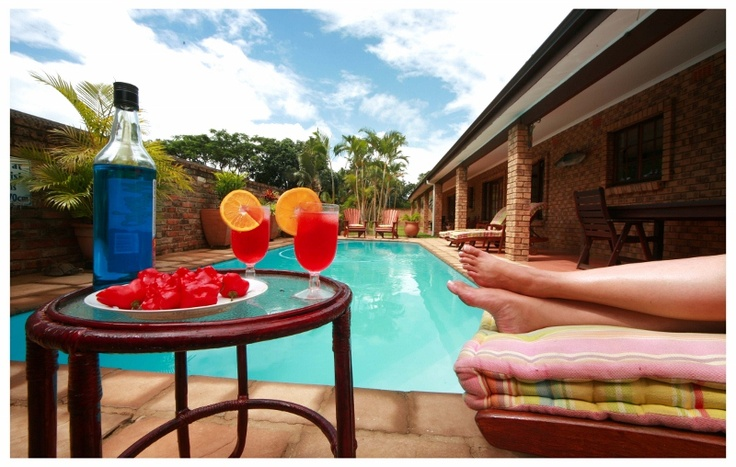Relaxing next to the pool... cocktail in hand... summer glorius summer... http://wikivillage.co.za/marlin-lodge-st-lucia