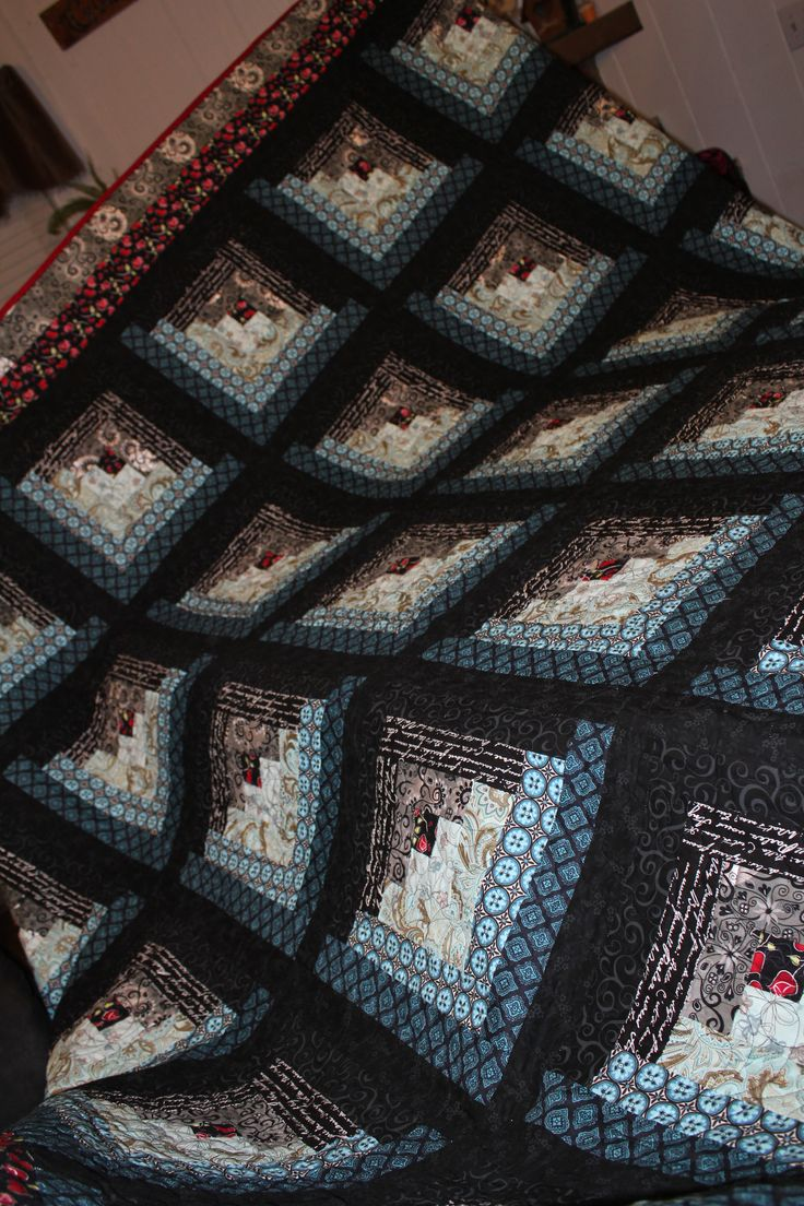 This is my log cabin quilt I created from blues and blacks for my husband for our anniversary. It is a king size and I did have to send it out to be quilted when I finished it.