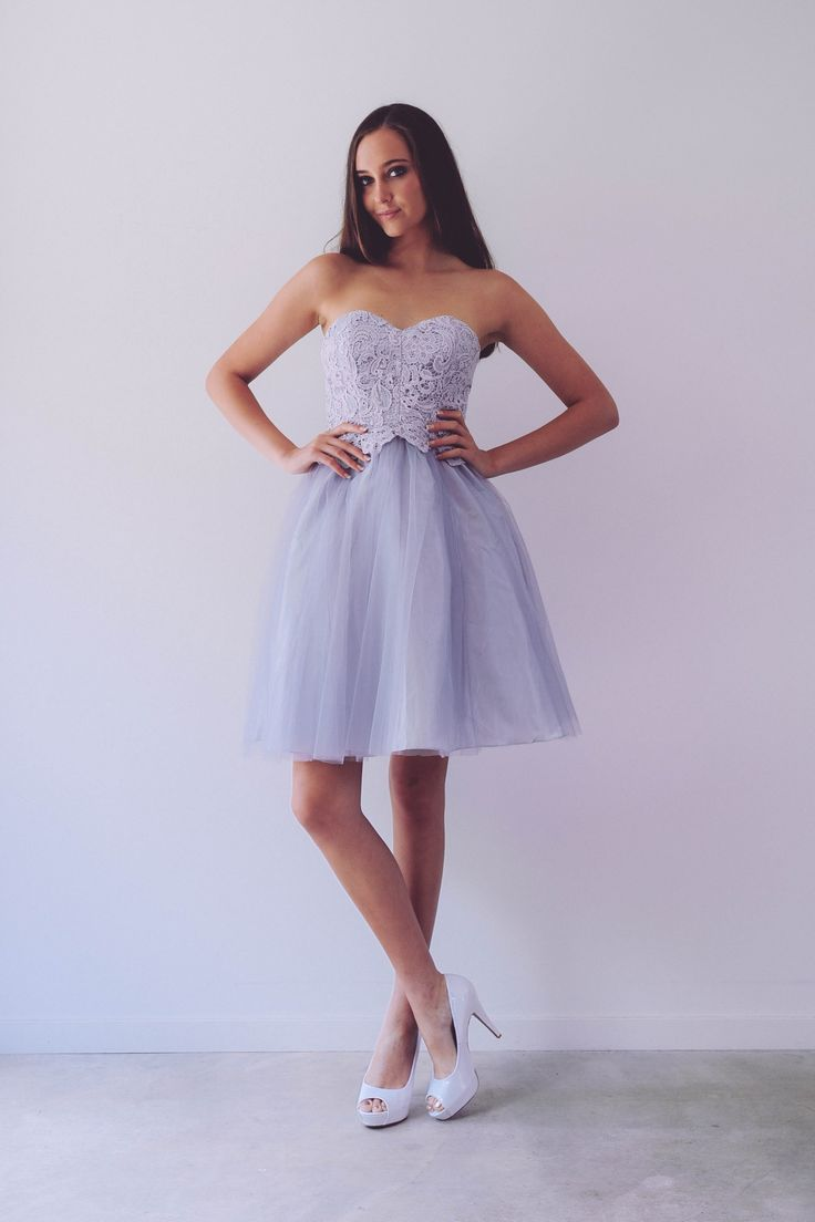 Poppy Cocktail - A sweet tulle and lace combo! Just evening gown, perfect for formals or bridesmaids. Fully laced gown with key hole back and subtle train detail.Other colours available. Dry Clean Only