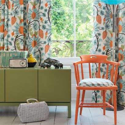 retro modern vintage style orange chair, green patterned curtains