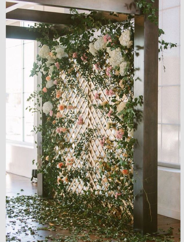 Enchanted forest backdrop. A beautiful, modern twist on the flower wall - it would be perfect for your ceremony or for a photo booth backdrop.