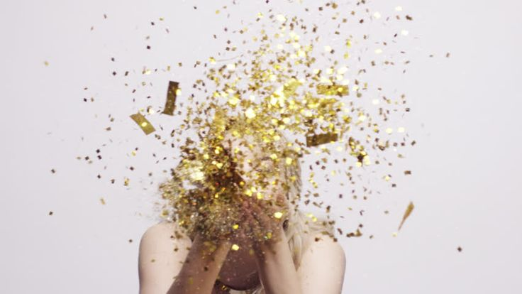 Beautiful woman blowing gold glitter confetti slow motion - Red Epic Dragon - HD stock video clip