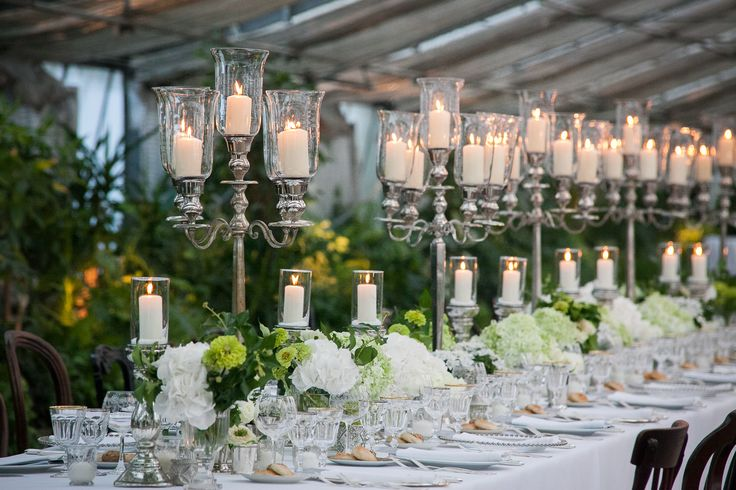 In the greenhouse, the table set up is wow effect! Brigh and romantic with high candelabras and old dishes all different.