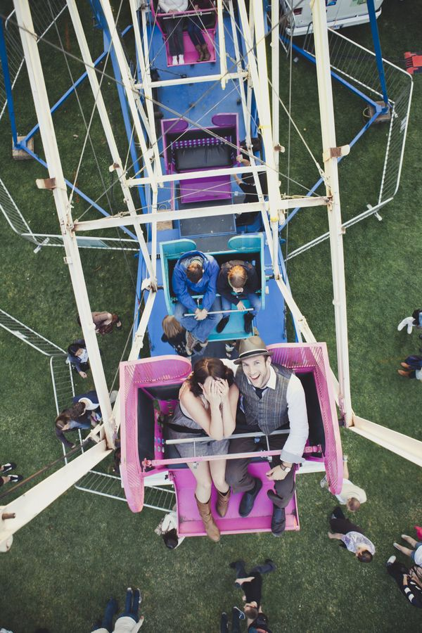 A carnival engagement, photo by Ameris Photography
