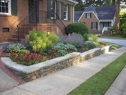 Stacked stone raised flower bed gardening ideas that i for Landscaping flower beds with stones