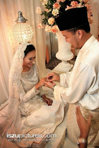 Traditional: White baju kurungs with a little bit of bling!