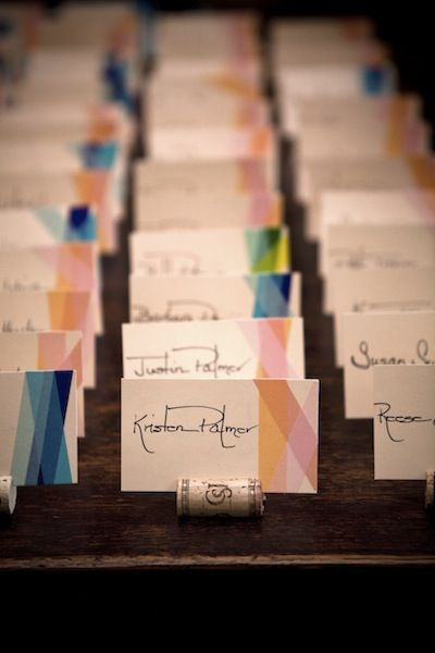 The Pain au Chocolat escort cards with wine cork stand, washi tape stripes (for indicating meal choice), and custom calligraphy by the groom's mom.