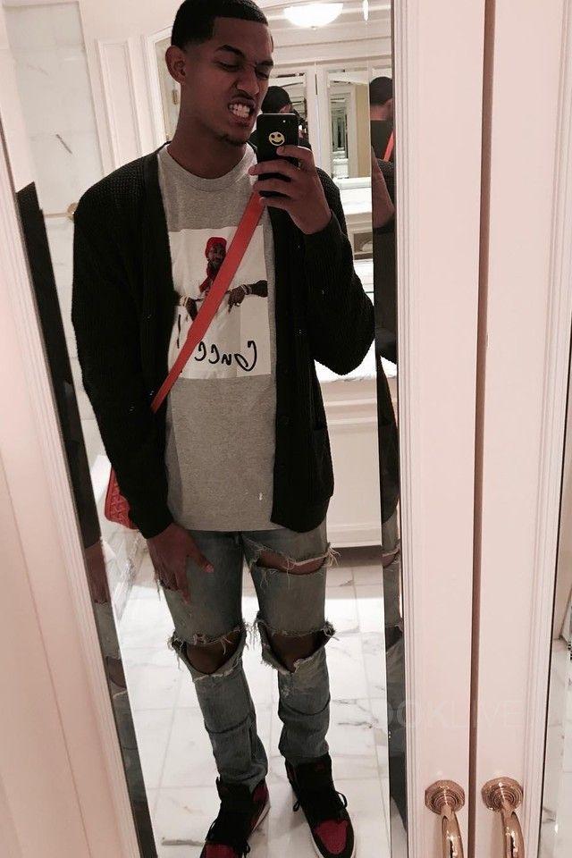 Jordan Clarkson  wearing  Supreme Gucci Mane T-Shirt, Fear of God Selvedge Denim Vintage Indigo Jeans, Jordan Air Jordan 1 Retro High Bred