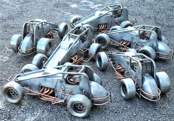 Pile of cold hard art sprint cars motorsports art rig welding racing