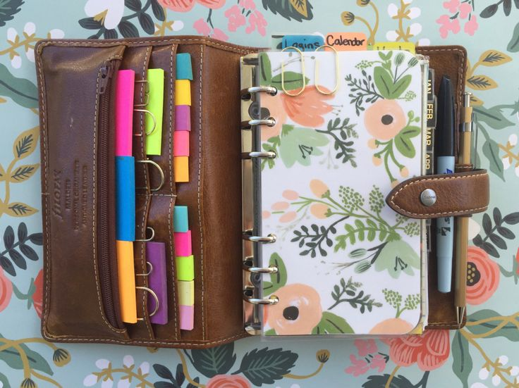 "A peek inside my beloved personal size FiloFax Malden organizer in Ochre. Custom made dividers from Rifle Paper Co. wrapping sheets that I laminated at FedEx Office. ""Trombone"" shaped paperclips fr..."