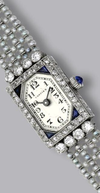 PLATINUM, SEED PEARL, SAPPHIRE AND DIAMOND WRISTWATCH, CIRCA 1925 Old European-cut, rose-cut and single-cut diamonds weighing approximately .80 carat, manual movement, dial signed Cartier, French assay marks, length 6 1/2 inches.  With signed box.