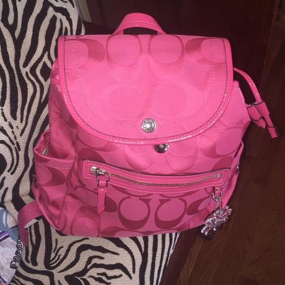 NEW Coach Backpack GORGEOUS NEVER USED. NEW. Coach Backpack !!!! Pink and beautiful!   share these please follow me on Instagram: @sassy_angieeexo if you have any questions comment below gently used please ask for additional pictures, I will be glad to help, & if needed ask questions before you purchase! No trades or other apps Ships next business day  Reasonable offers accepted, no lowballs Five Star Rating  Bundle for Discount Coach Bags Backpacks