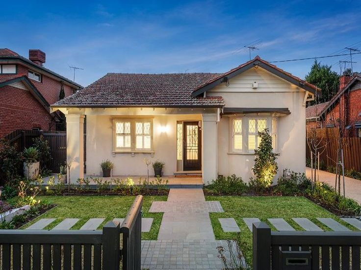 Pavers californian bungalow house exterior with porch & landscaped garden