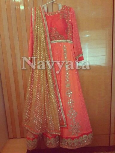 Floor length anarkali with handwork on raw silk yoke. Alternate kalis are made up of lucknowi n mirror work. Teamed up with heavy net dupatta