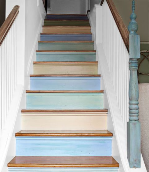 "Interior designer Lisa Teague set the palette for her whole house by brushing a spectrum of shades on the risers of her staircase—the first thing people see when they walk in the door. ""I wanted to make a statement, but a subtle one,"" she explains. To achieve a lightly weathered effect, Teague mixed glaze into the paint. Plus: 5 more ways to add color to your home »"