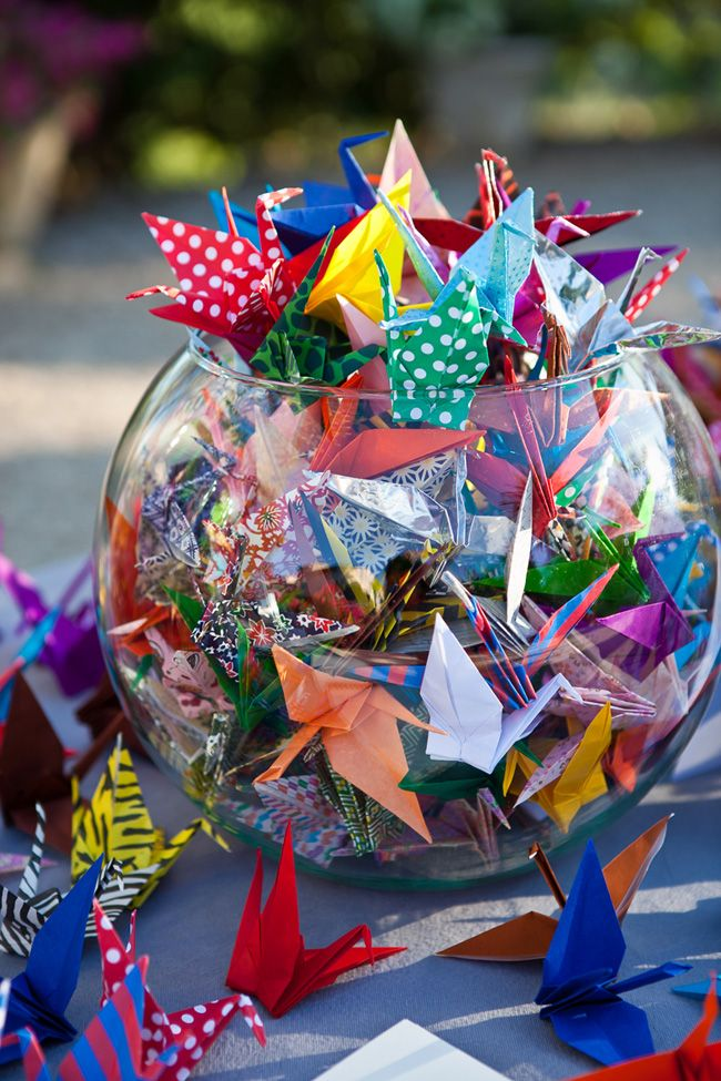 There is an old Japanese tradition that if you fold a 1000 origamis and have them at your wedding, you will have 1000 years of good luck and prosperity.