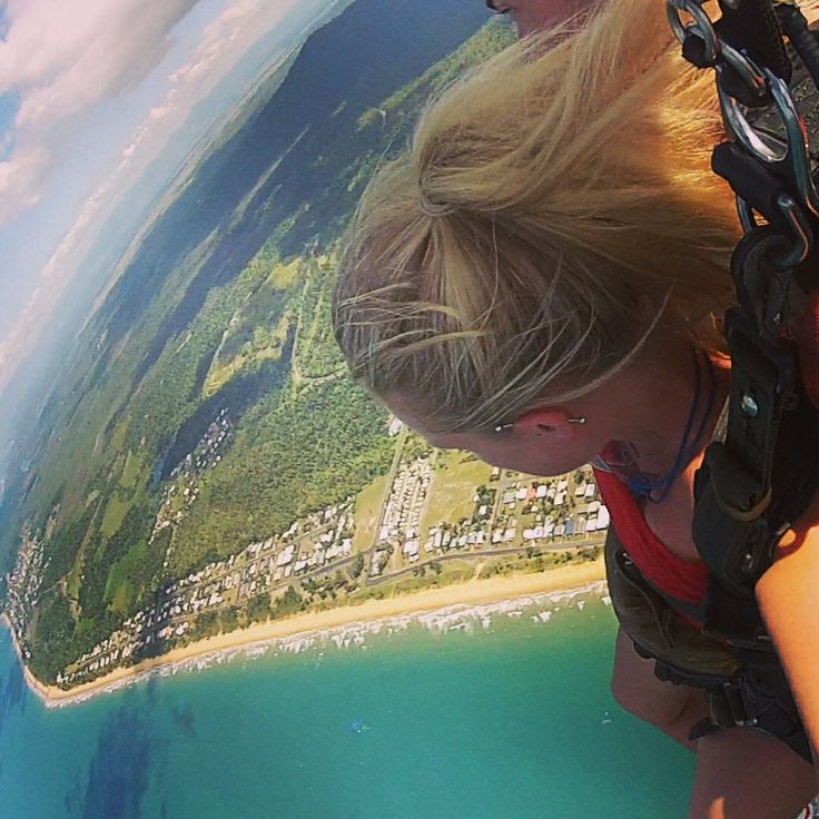 Skydiving at 14,000 ft over the Great Barrier Reef and landing on mission beach, Australia.