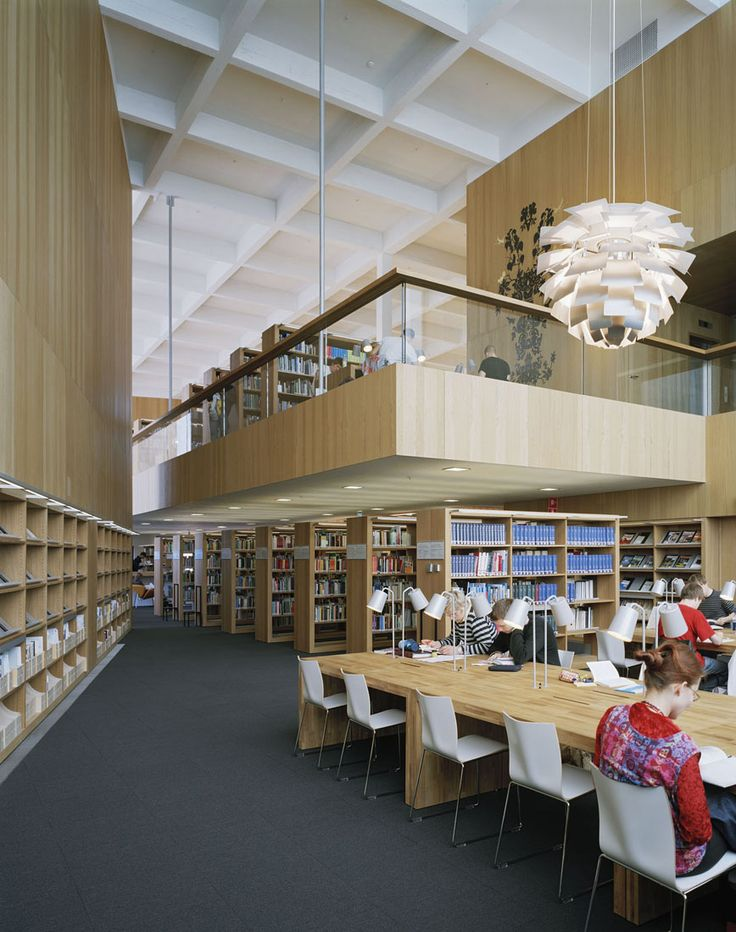 Borrow a movie or book from the library. Turku City Library / JKMM Architects