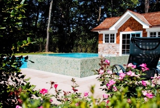 Pools - Eclectic Chaise Lounge Chair Near Modern Pool Landscaping Ideas With Mosaic Tile Old French Door Stone Wall: Artistic Pool Landscaping Ideas for Your Modern House