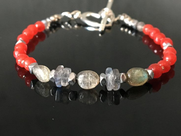 A personal favourite from my Etsy shop https://www.etsy.com/no-en/listing/536203623/red-ruby-bracelet-grey-labradorite